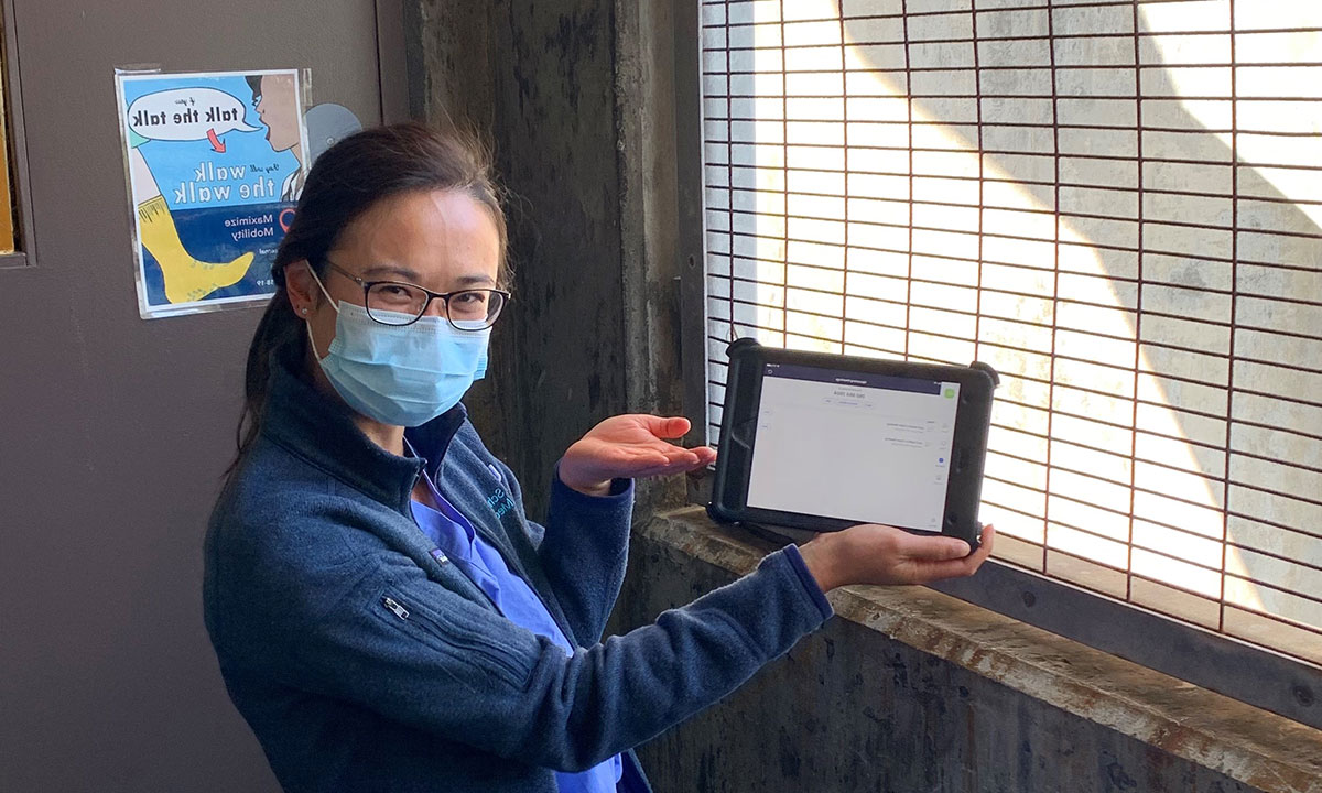 Medical resident holding tablet