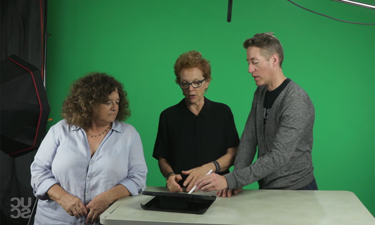 Three instructors in front of green screen